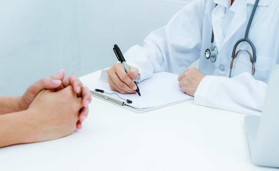 Doctor looking at Medical Review Officer